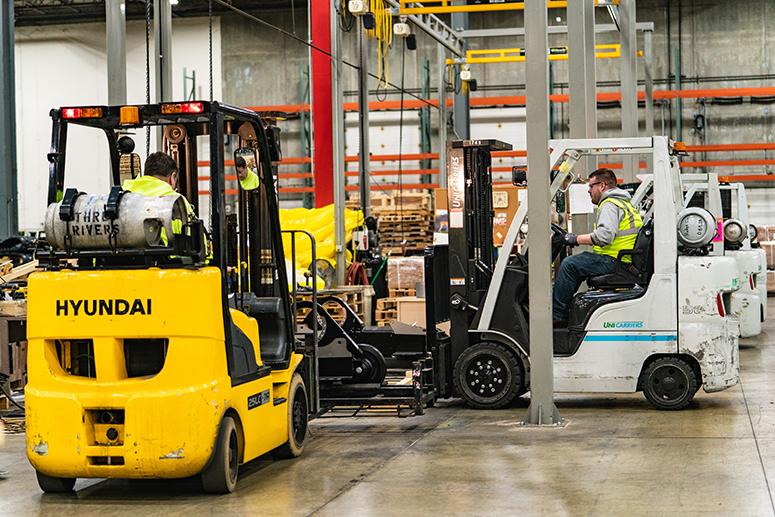 forklifts-in-warehouse-to-web